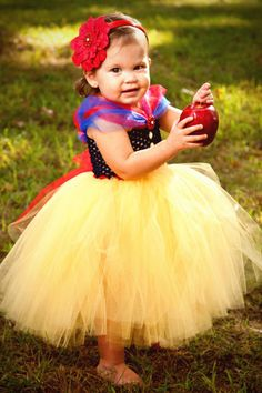 Disney snow white theme wedding ideas from bridalguide.com  |  The Flower Girl  -  What's more adorable than a mini Snow White as the flower girl? Your guests won't be able to resist oohing and ahhing at this cuteness. Outfit by Blissy Couture Tutus.
