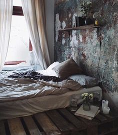 Pallet bed and oil/decoupage wall.