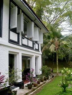 Black and White Colonial House of Singapore. It is the intersection of architecture, climate, and time. At the time of British colonial rule, the heat of Singapore was mitigated by openness, breezy architecture as embodied in window shutters.