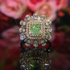 @sammi666_superjewellery.  In the most intricate and eye catching design set with green and white diamonds.