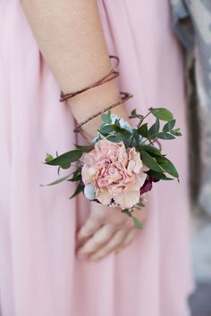 pretty corsage for a bridesmaid - photo by Alexa's Photography http://ruffledblog.com/candy-colored-wedding-inspiration-in-charlotte #bridesmaids #weddingideas #flowers