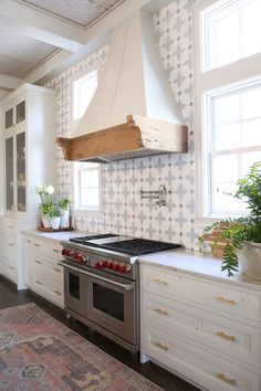 coffered ceiling with wood inlay. Love the layout. paneled refrigerator. pot filler large stove/oven