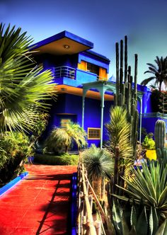 Jardin Majorelle, Marrakech, Morocco YSL's home reflects the brilliant colour combinations of his couture masterpieces. The vivid blue and yellow juxtaposed with gigantic cactus specimens is brilliant. Hope to visit in person some day soooon! Jardim Majorelle, Places Around The World, Around The Worlds, Moroccan Theme, Moroccan Blue, Morocco Travel, Marrakech Travel, Photoshop Fail, Colourful Buildings