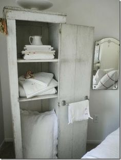 A cupboard like this beside a claw foot tub would be perfect.