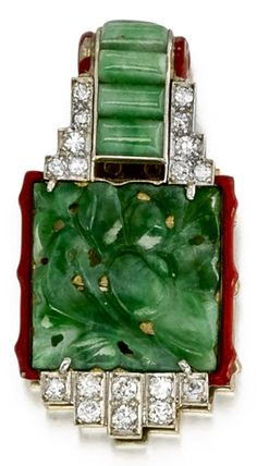 An Art Deco carved jadeite jade, diamond and enamel brooch, Cartier, circa 1925. Designed as a carved jadeite jade panel within an openwork surround, set throughout with old brilliant-cut and single-cut diamonds, to jadeite jade rectangular details, framed with red enamel borders; signed Cartier, numbered; mounted in platinum; length: 1 1/2in. #Cartier #ArtDeco #brooch