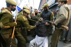 Indian policemen detain a physically disabled Kashmiri during a protest to mark International Day of People with Disability in Srinagar, India, Tuesday. The annual observance of this day aims to promote an understanding of disability issues and mobilize support for the dignity, rights and well-being of persons with disabilities. ■ Photo: Dar Yasin (AP)