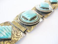 Vintage 1950's Panel Bracelet Stamped Silvertone Panels Molded Turquoise Cabachon. $22.00, via Etsy.