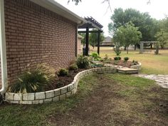 This is a beautiful flower bed landscape and flowerbed boarder GroundScape installed in Burleson Texas. If you would like an estimate for a flowerbed or flowerbed boarders give us a call at Flower Bed Edging, Flower Beds, Landscaping Company, Boarders, Burleson Texas, Beautiful Flowers, Sidewalk, Landscape Designs, Patio