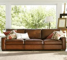Turner Leather Sofa | Pottery Barn - I love the pillows, would look good on our couch