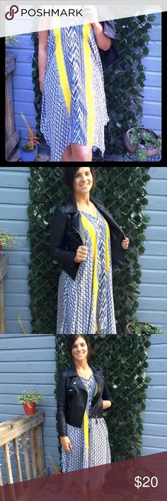 Flowy Asymmetrical Black and White Dress! This is such a funky piece to pair with a leather bomber or moto jacket and some cutout ankle booties for a carefree night out! Light, airy material...super forgiving! Make an offer! Motivated to sell! Dresses