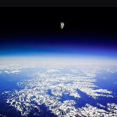 An amazing photo of Bruce McCandless II performing the first unassisted space walk in 1984.