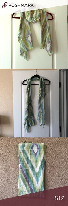 Patterned ikat scarf This is such a perfect lightweight scarf for spring and summer. The ikat pattern is done in green and purple, so it's a perfect accent piece. LOFT Accessories Scarves & Wraps