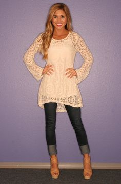 White lace tunic, cuffed skinnies, neutral wedges