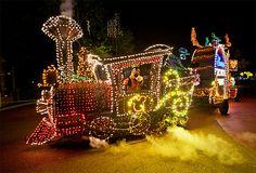 Main Street Electrical Parade . Goofy driving train .