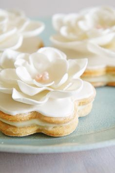 Vanilla Sandwich Cookies Filled With White Chocolate Ganache, Iced With Royal Icing & Decorated With A Fondant Flower. Cupcakes, Cupcake Cookies, Sugar Cookies, Flower Cookies, Vanilla Cookies, Rose Cookies, Blossom Cookies, Fondant Cookies, Tea Cookies