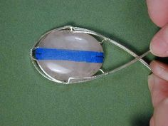 How to Wire Wrap a Cabochon for jewelry making! #Wire #Jewelry #Tutorials