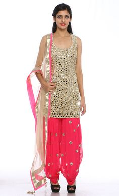 Mirror Patiala Salwar Suit This set features a gold silk shirt with all over mirror work and gold sequins embellishment. It has a deep cut out back along with a matching dori tied up with gold and silver latkan tasseled hangings. It is paired with a contrast hot pink patiala salwar in georgette fabric with silver sequins botis all over. It comes along with a matchng net dupatta with silver shimmer border.