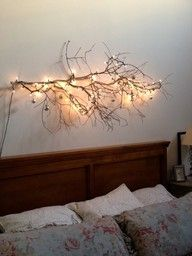 a branch with twinkle lights makes an inexpensive sculptural light fixture.