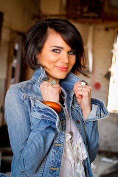 Side part. Side-swept bangs. Bob hair. Cute denim jacket and colorful accessories