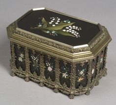 Pietra Dura Mounted and Silvered Metal Jewelry Casket, late 19th century, rectangular with canted corners, the silver metal mounts cast with leaftip and foliates, hinged lid with large lily-of-the-valley pietra dura, the sides with vertical foliate pietra dura panels accented with cast foliate metal mounts, satin lined interior, wd. 11, dp. 7 1/4, ht. 6 1/4 in.
