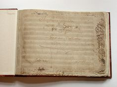 """Title page of Beethoven's """"Eroica"""" symphony, with the hole he tore in the paper clearly visible. Beethoven was going to dedicate the symphony to Napoleon Bonaparte until he heard that Napoleon had declared himself Emperor."""