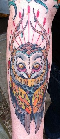 Deer owl tattoo with antlers
