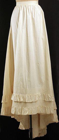 1880 ca.  Petticoat, British.     Cotton, cream colored, frills around wide hem.  metmuseum.org