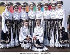 KYRGYZ REPUBLIC - MARCH Kyrgyz women gather in traditional dress to celebrate International Women's Day on March 8 2009 in the Kyrgyz Republic. Folk Clothing, Beauty Around The World, Tribal Dress, Folk Embroidery, Legging, Folk Costume, Festival Wear, Sewing Clothes, Ladies Day