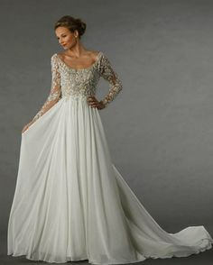 Long sleeve wedding dress. Intricate beaded lacy top with flowing chiffon skirt.