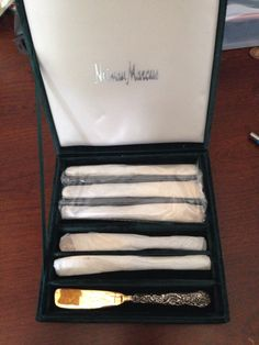 Neiman Marcus silver and gold spreaders.  Brand new.