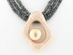 Entry 322  Denny Wong  Denny Wong Designs  Honolulu, HI  18K white and rose gold pendant featuring a freshwater Pearl accented with Diamonds (.08 ctw.) on strands of rough Diamonds (55.0 ctw.)