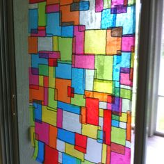Another one of my faux stained glass projects.   Vinyl, mod podge, tissue paper and sharpie marker.