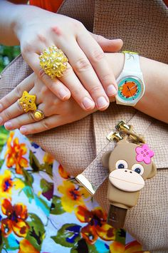 Funky watch + Yellow rings + Bright colors