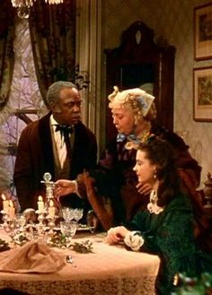 Gone With The Wind - Christmas dinner at Aunt Pittypat's house. Her coachman, Uncle Peter, has brought in the last bottle of wine to celebrate Ashley's three-day furlough.