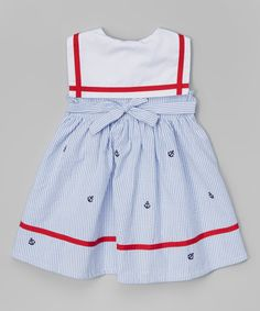 Adorably timeless, this dress shows off a sweet silhouette and darling details like stripe trim, anchor-emblazoned buttons and a big red bow at the neck.