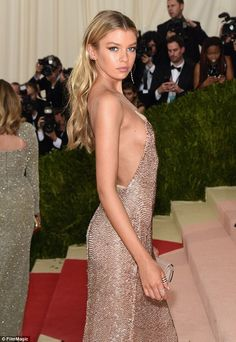 Stunning: The 24-year-old supermodel turned heads as she proffered a cheeky glimpse of sideboob to her vying admirers in her risque gown