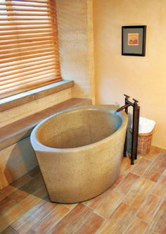 Sonoma Cast Stone - Ofuro  The stout but luxurious Nucrete Ofuro soaking tub measures 55 inches long and holds 70 gallons of water. The tub is made from precast concrete in 20 colors formulated to resist stains—even in demanding hospitality applications. Or you can choose concrete in custom colors. 133A Copeland Street, Petaluma, CA 94952; 707-789-9130; sonomastone.com.
