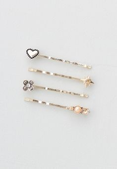 Lilla Rose Inc - The Hope Set in gold tones includes a flower stoneset, small heart, bright star, and an arrangement of colored stones such as peach and lite topaz. Set of 4 bobby pins with Lilla Rose display card.