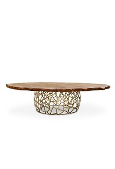 APIS DINING TABLE II   The imposing of this table is represented by a top that retraces the torso of big and ancient trees and in a base inspired on the golden beehives, that together results in a piece of nature translated into a piece of furniture.