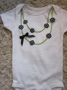 Double strand necklace applique onesie or tee in navy and green. $18.00, via Etsy.