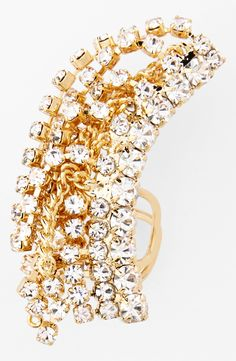All about this stunning crystal-encrusted cuff.