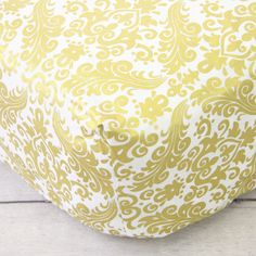 This Caden Lane Gold Damask Crib Sheet is the perfect way to add gold into your pink and gold nursery design!