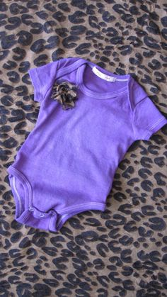 Hand dyed purple Peek-a-poo onesie with cheeta flower accent. $20.00, via Etsy.