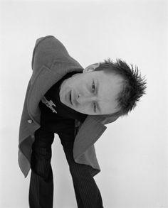 Thom Yorke. Love his coat and pinstripe pants.