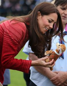 Catherine, Duchess of Cambridge is given a toy during a visit to Strathearn Community Campus on May 29, 2014 in Crieff, Scotland.