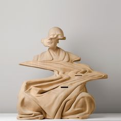 Perth-based artist Paul Kaptein works with large blocks of laminated wood to reveal warped and distorted human figures, some pierced with a smattering of holes linked with drawn lines like star constellations. The hand-carved busts and figurative sculptures are additionally punctuated by gaps formed