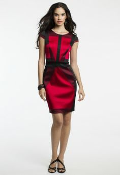 Geometrically inclined, this gorgeous short dress is a bold way to make a statement in any party setting. The stretch satin material is worked in such a way that sharp lines form a slim silhouette giving you an awesome waistline! The edgy color-block pattern is a hot trend for this fall season and it's so very sexy