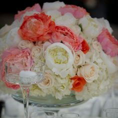 Lush roses and peonies make up luxurious enterpieces.