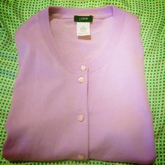 J. Crew Spring Cardigan Beautiful lilac color sweater by J.Crew is the perfect spring cardigan. Gently loved, no pilling, no stains, no tears or flaws. Pearly buttons, three quarter sleeves, machine washable cotton. J. Crew Sweaters Cardigans