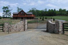 Rock wall driveway entrance